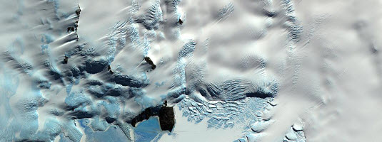 ASTER image, Erebus glacier, Ross Island, Antarctica © NASA/GSFC/METI/ERSDAC/JAROS 2001 - Best wishes for a Merry Christmas and a Happy New Year. Many thanks to all of our clients, partners, colleagues and friends for their patronage throughout the year.