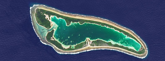 Landsat-8 image (resolution 15 m, 28.07.2014), Nikumaroro atoll (aka Gardner Island), Pacific Ocean, © 2014 USGS, NASA - Human bones and artifacts found on this uninhabited and remote atoll indicate that it may be the place where lost pilot Amelia Earhart and her navigator Fred Noonan died in 1937.
