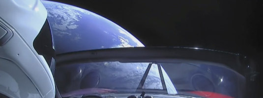 SpaceX camera image (06.02.2018), Starman in the Tesla car orbiting Earth, © 2018 SpaceX - The red car Tesla Roadster with the dummy Starman, a test load on the first Falcon Heavy rocket flight, was successfully placed into orbit around the Earth and later into orbit around the Sun.