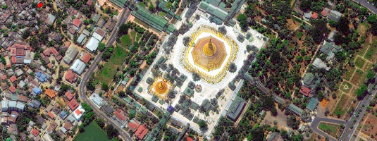 WorldView-2 image (resolution 50 cm, 28.04.2010), Yangon, Myanmar (Burma), © 2010 DigitalGlobe - The Golden Shwedagon Pagoda is 99 meters tall, made of bricks covered with gold plates and crowned with diamonds and rubbies. It is the most sacred Buddhist pagoda in Myanmar.